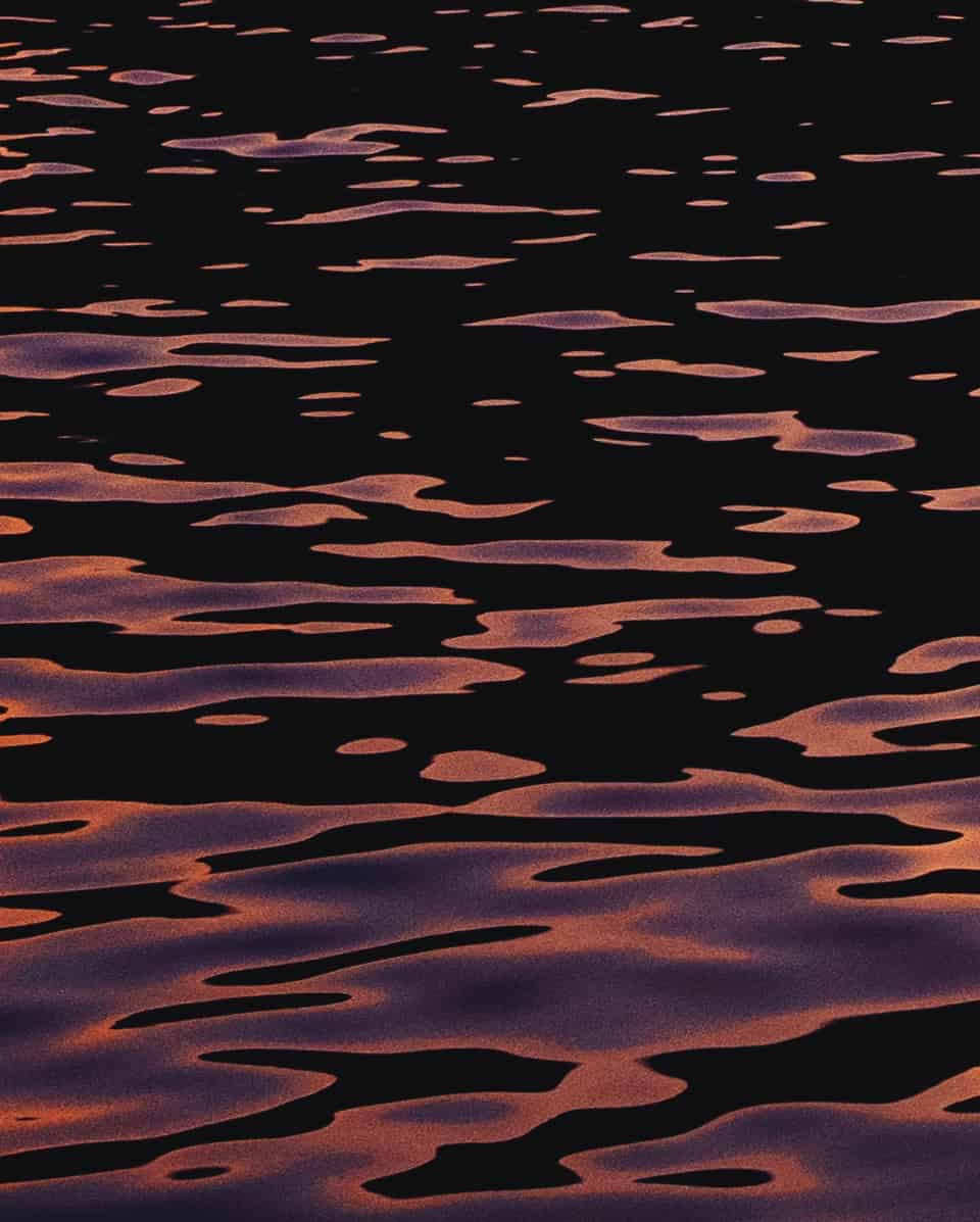 Dark water with purple reflection