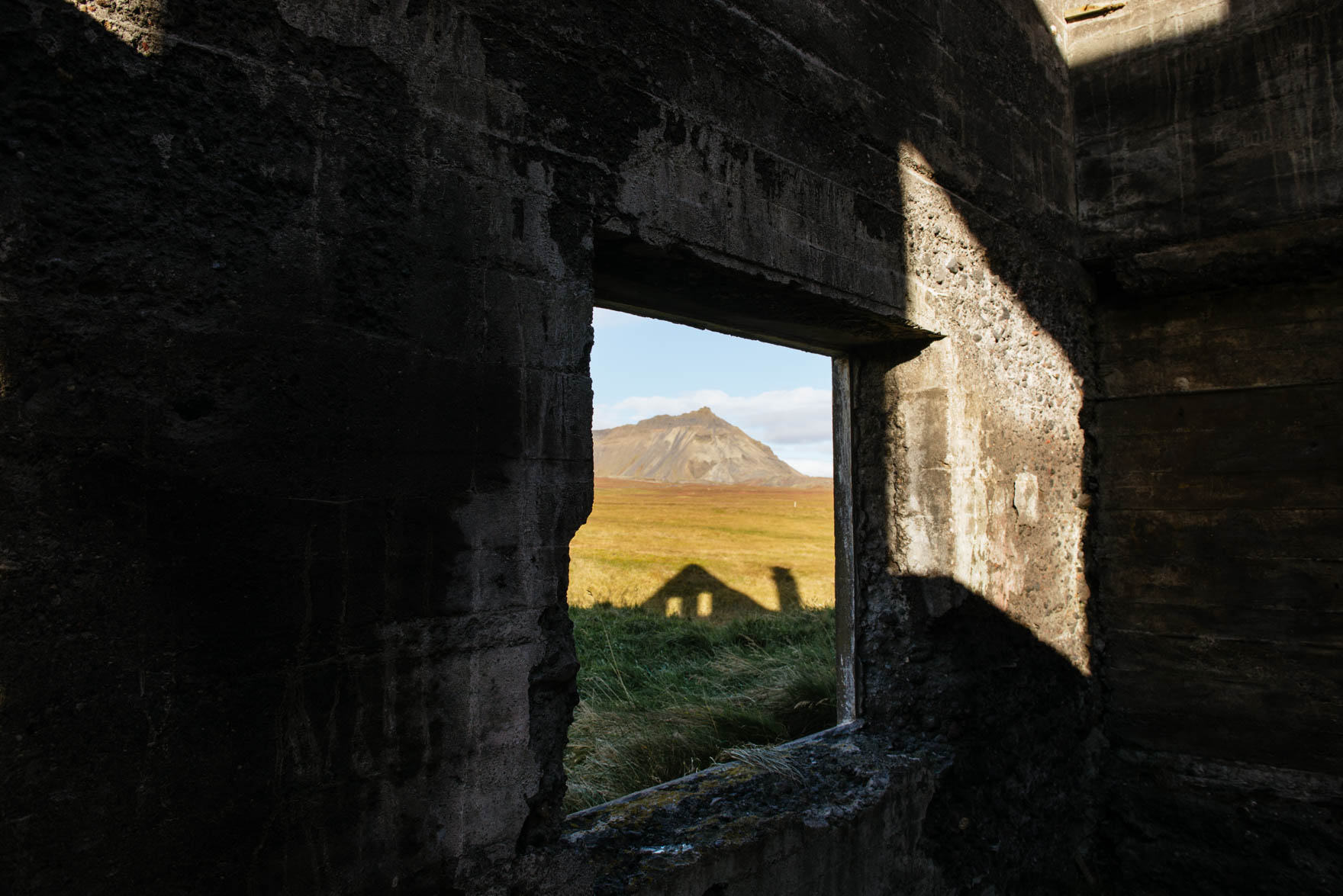 Shadow of house casted onto mountain landscape in Iceland