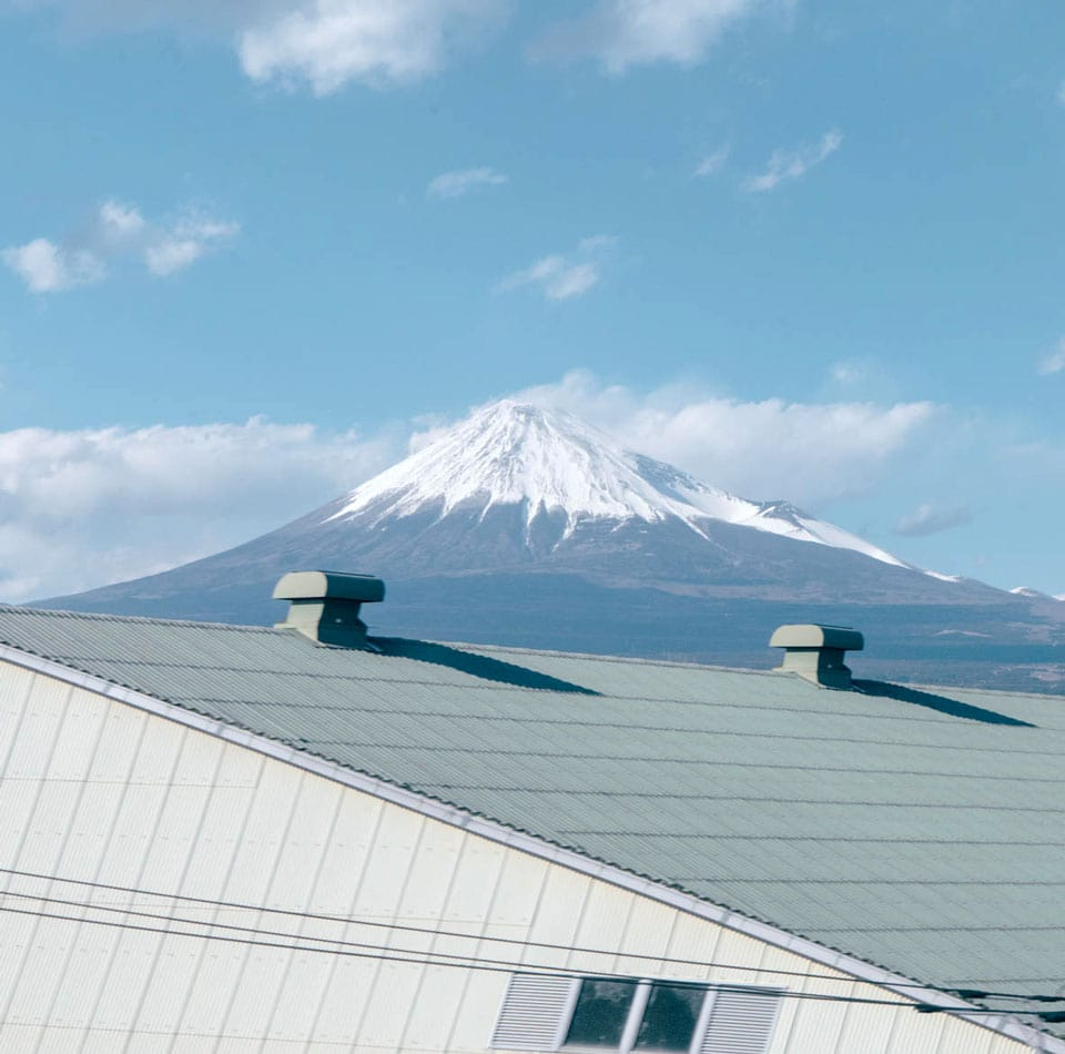 Mount Fuji is seen behind a roof