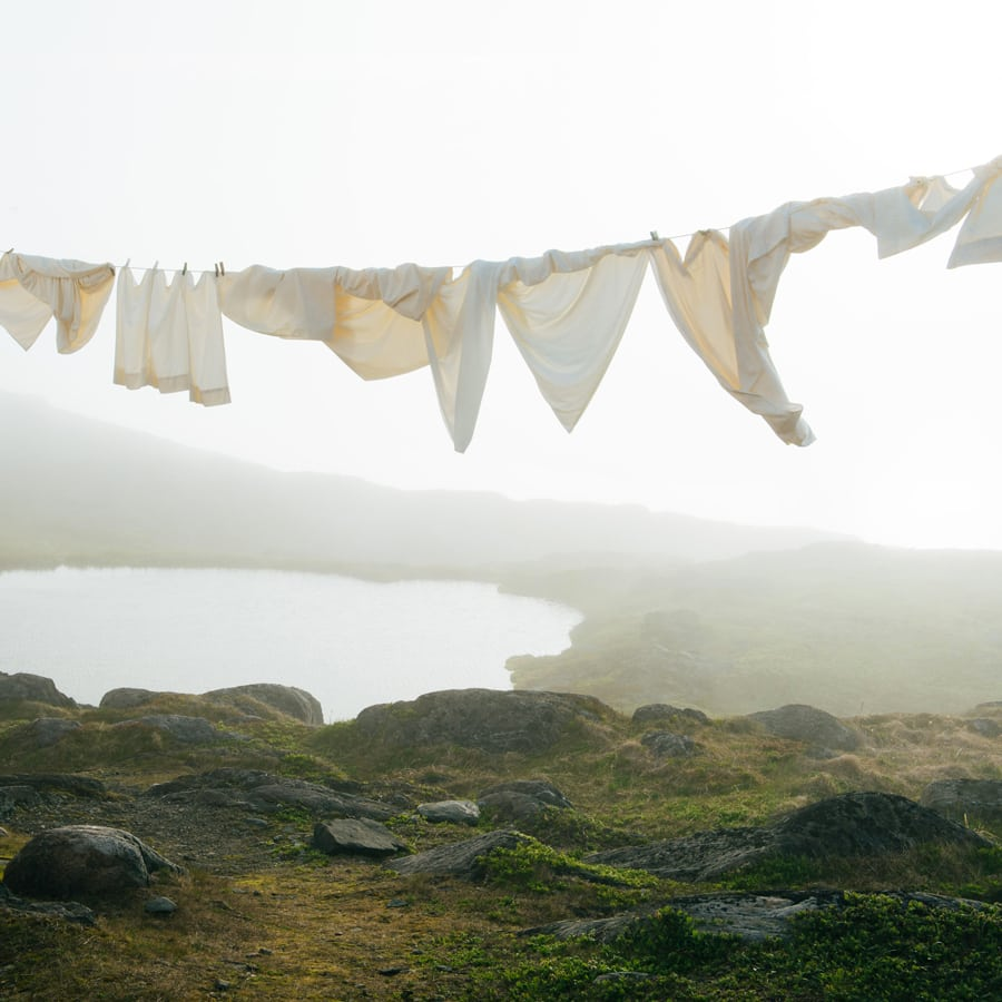 Laundry flowing in the mist over a lake